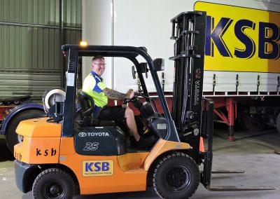Chris on a Forklift